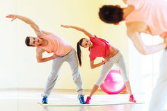 Two young people in the gym doing exercises for fitness Royalty Free Stock Image