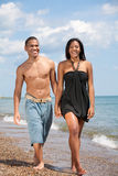 Two Young People Holding Hands by Beach Stock Photography