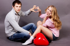 Two young people holding heart-shaped balloon Royalty Free Stock Photography