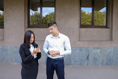 Two young people, international students, communicate, solve pro Royalty Free Stock Images