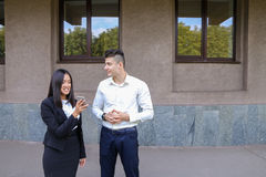 Two young people, international students, communicate, solve pro Royalty Free Stock Image