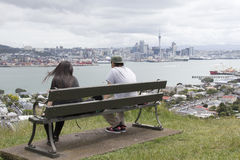 Two young people looking at Auckland city and harbour from Devonport Stock Photography