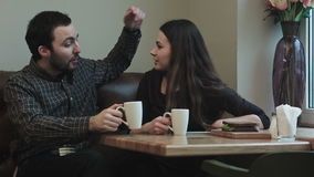 Two young people looking communicate in cafe stock video footage