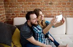 Happy couple making selfie. Stock Image