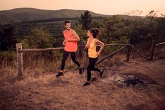 Two young people, man woman, happy smiling, runners running outd Stock Photography
