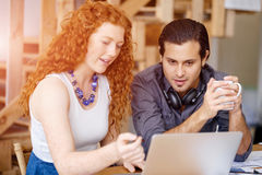 Two young people in office. In casual clothes Royalty Free Stock Photos