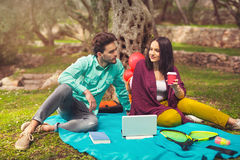 Two young people on picnic sitting on blanket Stock Images