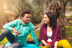 Two young people on picnic sitting on blanket Stock Image