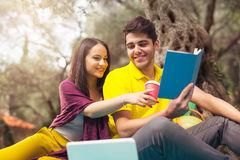 Two young people on picnic sitting on blanket Stock Photography