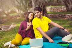 Two young people on picnic sitting on blanket Royalty Free Stock Photos