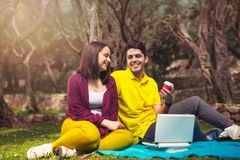 Two young people on picnic sitting on blanket Stock Photo