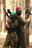 Two young people playing paintball Stock Photos