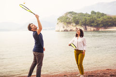 Two young people playing on the seashore speedminton Royalty Free Stock Images