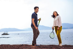 Two young people playing on the seashore speedminton - badminton Stock Photo
