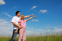 Two young people pointing fingers Stock Photo