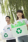 Two Young People Recycling Plastic Bottles Stock Photo