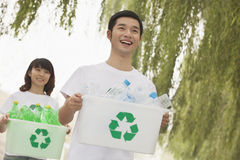 Two Young People Recycling Plastic Bottles Royalty Free Stock Photo