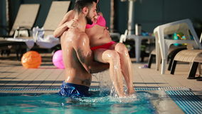 Two young people relaxing in the swimming pool stock footage