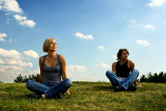 Two Young People Sitting On The Grass Stock Photography