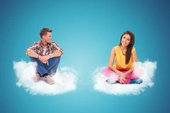 Two young people sitting and resting on couds stock photos