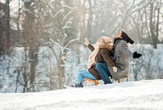 Two young people sliding on a sled royalty free stock photo