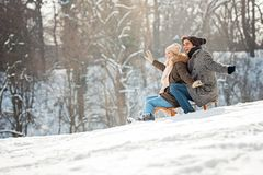 Two young people sliding on a sled stock photography