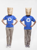 Two young people with smiley face paper bags over their head Stock Photos