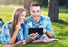 Two young people with a tablet outside Stock Image