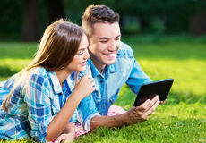 Two young people with a tablet outside Stock Photography