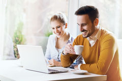 Two young people using a laptop Royalty Free Stock Image