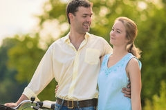 Two Young People Walking in the Park Together Embraced and Smili Royalty Free Stock Photos