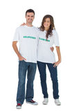 Two young people wearing volunteer tshirt Royalty Free Stock Photos