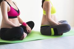 Two young pregnant women doing yoga exercises Royalty Free Stock Image