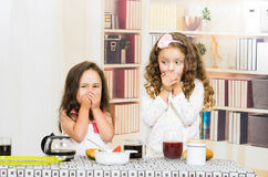 Two young preschooler girls covering their mouths Royalty Free Stock Image