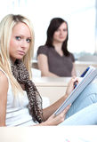 Two young pretty female college Royalty Free Stock Photography