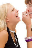 Two young pretty girls laughing. On white background Stock Photography