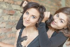 Two young pretty girls making new hairstyler Stock Photos
