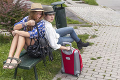 Two young pretty girls while traveling. Summer vacation Stock Photo