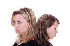 Two young pretty pouting woman Royalty Free Stock Image
