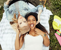 Two young pretty teenager girls best friends laying on grass making selfie photo having fun, lifestyle happy people Stock Photos