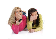 Two young pretty woman watching tv royalty free stock photography
