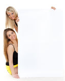Young  women with empty board for the text. Royalty Free Stock Photos