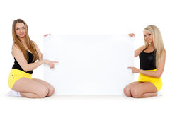 Young  women with empty board for the text. Royalty Free Stock Images