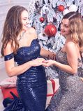 Two young woman in a beautiful dress at studio Stock Photo