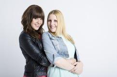 Two young pretty women togheter. Open to interpretations Stock Photos