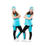 Two young professional cheerleaders posing at studio. Stock Image
