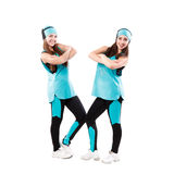 Two young professional cheerleaders posing at studio. Isolated over white Stock Photography