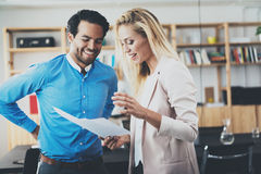 Two young professionals making a great business discussion in modern office.Successful confident hispanic businessman Stock Photos