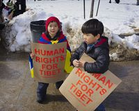 Two young protestors. Boston, Massachusetts USA - March 2013 - Two young boys holding signs Human Rights For Tibet during the Boston Free Tibet march through the Stock Images
