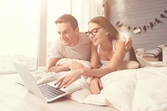 Two young relaxed people spending morning in bed stock photography